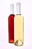 Witte en rode wijnflessen royalty-vrije stock afbeeldingen