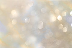Witte en zilveren abstracte bokehlichten De achtergrond van Defocused royalty-vrije stock afbeeldingen