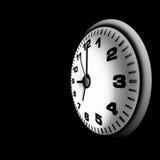Witte geïsoleerdea klok over zwarte achtergrond stock afbeeldingen