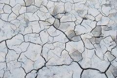 Witte gebarsten aardegrond royalty-vrije stock foto