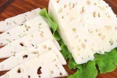 Witte geitkaas en salade stock afbeeldingen