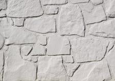 Witte geschilderde steenmuur stock foto