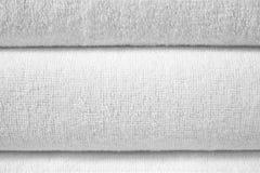 Witte gevouwen badstoftextuur stock fotografie
