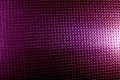Witte gloed op een purpere achtergrond in een zwarte punt royalty-vrije stock foto