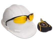 Helm, glazen en meetlint Stock Fotografie