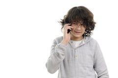 Witte jongen die op mobiel spreekt Stock Foto
