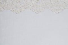 Witte kantachtergrond Stock Afbeeldingen