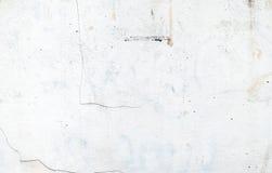 Witte kleurenverf op de muur van het grungecement, textuurachtergrond Stock Afbeelding