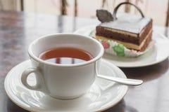 Witte kop thee en cake Stock Foto