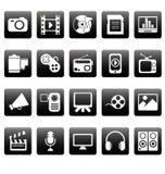 Witte media pictogrammen op zwarte vierkanten Royalty-vrije Stock Foto's