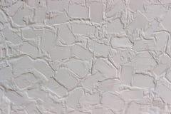Witte muur met abstract patroon als achtergrond of naadloze textu Royalty-vrije Stock Afbeeldingen