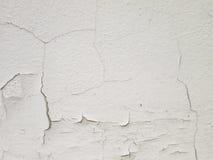 Witte muur met barsten Royalty-vrije Stock Afbeeldingen