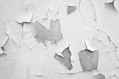Witte muur met barsten Stock Foto