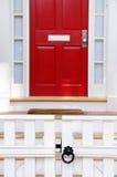 Witte Omheining, Rode Deur royalty-vrije stock foto