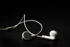 Witte oortelefoons Royalty-vrije Stock Foto's