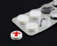 Witte pillen Stock Afbeeldingen
