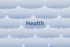 Witte pillen met de woord` Gezondheid ` Stock Fotografie
