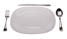Witte plaat met tablewares royalty-vrije stock foto