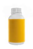 Witte plastic container met geel etiket en wit deksel stock afbeelding