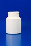 Witte plastic geneeskundecontainer Stock Foto