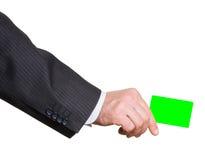 Witte plastic kaart in Geïsoleerde mensenhand Stock Foto