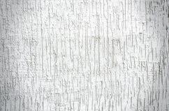 Witte pleistermuur met barstenachtergrond Stock Fotografie