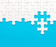 Witte puzzel op blauwe achtergrond Royalty-vrije Stock Afbeelding