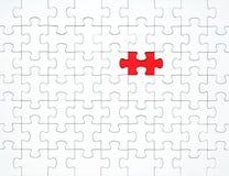 Witte raadselstukken op een rode gescheiden achtergrond stock afbeelding