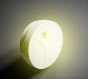 Witte rookdetector op lijst gele golven royalty-vrije stock fotografie