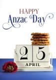 Witte sjofele elegante uitstekende stijlscheurkalender voor Anzac Day, 25 April, met traditionele Anzac-koekjes en steekproefteks Royalty-vrije Stock Afbeelding