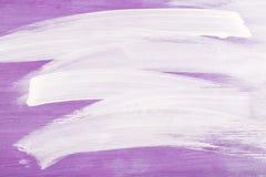 Witte slagen op violette houten achtergrond Royalty-vrije Stock Fotografie