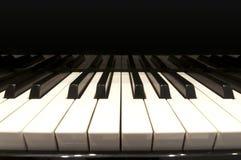 Witte sleutels van een grote piano Stock Foto's