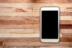 Witte slim op houten bureau Stock Fotografie