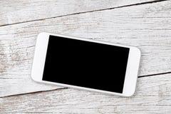 Witte smartphone op houten lijst royalty-vrije stock foto