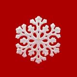 Witte Sneeuwvlok op Rode Achtergrond De wintersymbool Royalty-vrije Stock Foto's