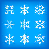 Witte sneeuwvlokken op blauwe achtergrond Stock Fotografie