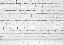 Witte steen blick muur en houten vloerachtergrond Royalty-vrije Stock Foto