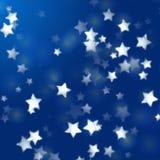 Witte sterren in blauw met veerlichten Stock Afbeelding