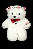 Witte stuk speelgoed teddybeer huidig voor een kind Zwarte achtergrond Stock Foto's