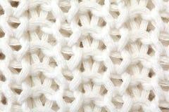 Witte sweater gebreide textuur dicht omhoog royalty-vrije stock afbeelding