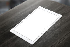 Witte tablet op houten lijst met het witte scherm voor model Stock Foto's