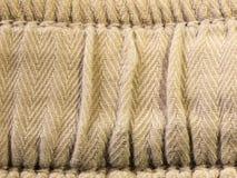 Witte taille van pjs binnen geribbelde doek Stock Foto
