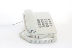 Witte telefoon op een lichte achtergrond Royalty-vrije Stock Foto's