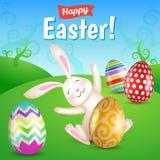 Witte vrolijke Pasen-konijntjeszitting in de weide Stock Afbeelding