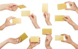 Witte vrouwelijke hand met adreskaartjes Reeks, op wit wordt geïsoleerd dat Royalty-vrije Stock Foto