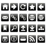 Witte Webpictogrammen op zwarte vierkanten Stock Foto's