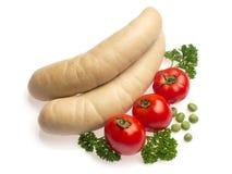 Witte worst met tomaat, peterselie en erwt Stock Foto's