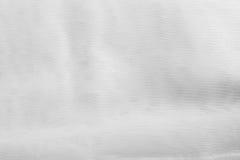 Witte zachte doekoppervlakte als achtergrond Abstracte witte textuur Royalty-vrije Stock Fotografie