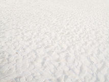 Witte zandachtergrond stock afbeeldingen