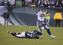 Witten. Dallas Cowboy tight end Jason Witten gets past Philadelphia Eagles Quintin Mikell for the final first down of the night in the fourth quarte of a 2009 Royalty Free Stock Photography